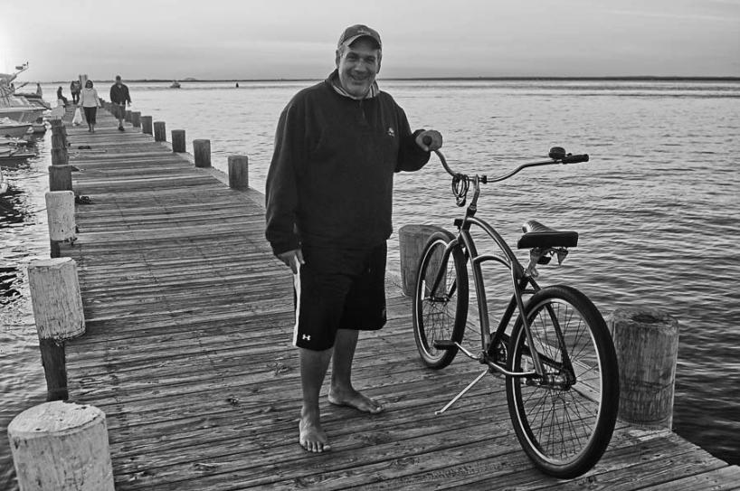 Lou with bike on bay.