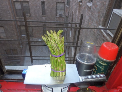 Summer asparagus on cleaver over courtyard.