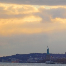 Statue of Liberty with Staten Island in background.