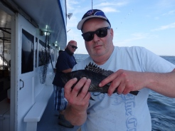 Jim with a short Sea Bass.