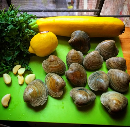 Prepping clam sauce.