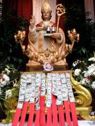 pay the saint at San Gennaro.